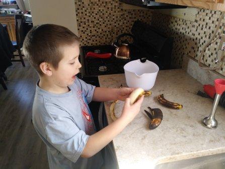 Elijah is peeling bananas.